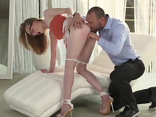 Milky white redhead gives a beautiful blowjob