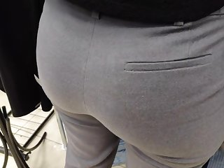 Delicious juicy butts saleswoman in very tight dress pants