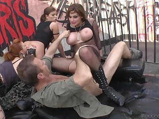 Three beautiful whores in lingerie have a wild foursome