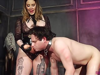 Thick Domme introduces her slave to her huge phallus