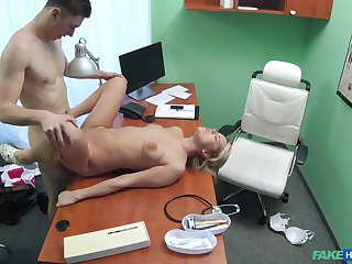 Young lady fucked on the desk inside of the clinic she works at
