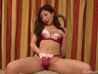 Japanese solo model Aise Kurara puts her hands connected with her tiny shoestring