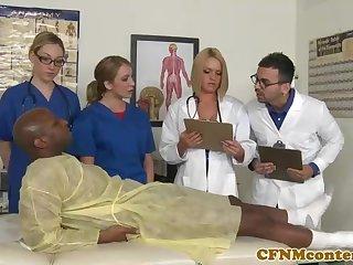 A kinky ebony patient is porking a saucy nurse who luvs to gargle rock hard sausages