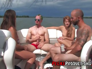 Slutty Canadian chick Kendra White takes part in crazy yacht orgy with strapons