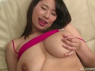 Haruna Hana masturbates on the bed thinking about friend's hard penis